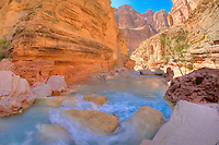 Havasu Canyon mouth, Grand Canyon National Park, Arizona, Havasu Creek with Colorado River Canyon beyond, Blue colors from calcium carbonate