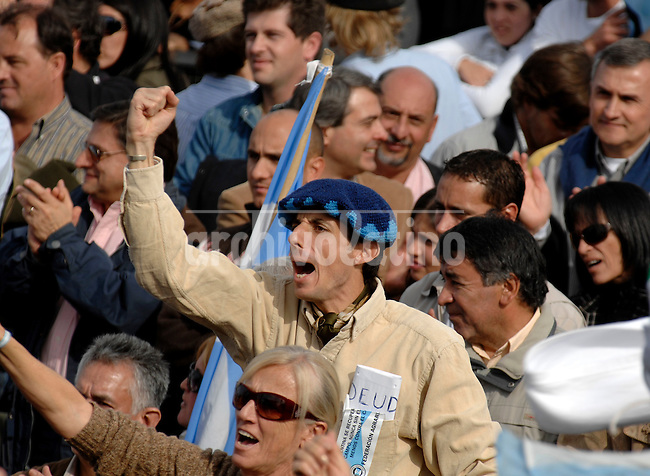 Farmers attend a protest in Rosario, Argentina, Sunday, May 25, 2008. Tens of thousands of farmers nationwide gathered to protest the government's new export taxes on soy and other grains.