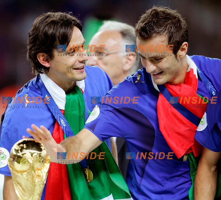 Berlino 9/7/2006 World Cup 2006 - Italia Francia 6-5 (d.c.r.).Italia Campione del Mondo. Photo Andrea Staccioli Insidefoto. Alberto Gilardino e filippo Inzaghi accarezzano la coppa del Mondo
