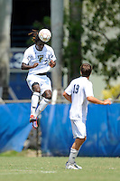 2 October 2011:  FIU defender Jahbari Willis (7) heads the ball in the second half as the FIU Golden Panthers defeated the University of Kentucky Wildcats, 1-0 in overtime, at University Park Stadium in Miami, Florida.