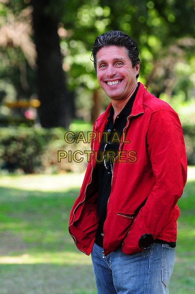 "RAUL CREMONA .Photocall for Film ""Anna e i cinque"" Rome, Italy, September 26th 2008..half length red jacket .CAP/CAV.©Luca Cavallari/Capital Pictures"