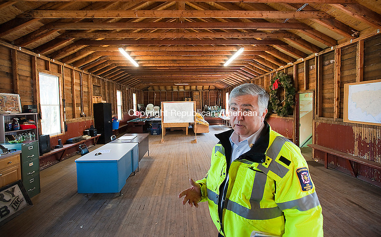 SOUTHBURY, CT-0424014JS04- Barry Rickerts, Southbury's fire marshal, talks about the new office in Southbury's new Point of Distribution at the old Grange Hall in Southbury. The hall has been renovated to serve as a place for emergency supplies to he handed out in the event of an emergency. <br /> Jim Shannon Republican-American