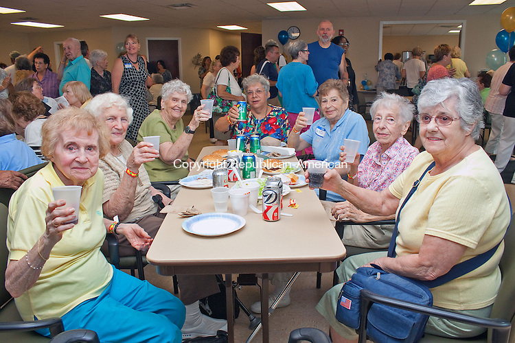 WATERBURY CT.-12 SEPTEMBER 2013 091213DA06- Ladies of Waterbury from left, Marie Urniezus, Laurine Ghent, Lucille Keating, Celeste Frigon, Cathy St.Pierre, Bette Lange and Barbara Bezanson enjoy lunch during the grand opening of the Waterbury Senior Center on East Main St. in Waterbury on Thursday. <br /> Darlene Douty Republican American