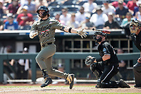 Vanderbilt Commodores first baseman Julian Infante (22) follows through on his swing during Game 3 of the NCAA College World Series against the Louisville Cardinals on June 16, 2019 at TD Ameritrade Park in Omaha, Nebraska. Vanderbilt defeated Louisville 3-1. (Andrew Woolley/Four Seam Images)