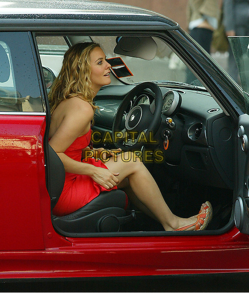 "ALICIA SILVERSTONE .The City of London Under Siege by Fake Armed Police Filming ""Stormbreaker""..On the set of ""Stormbreaker"".September 4th, 2005.full length red dress sitting in car.www.capitalpictures.com.sales@capitalpictures.com.© Capital Pictures."