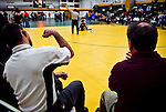 hamiltonp7A - The Wauwatosa side of the ring yells and cheers as a match goes on in the background, in Milwaukee on Thursday, December 23, 2010. Photographed by MARK ABRAMSON/MABRAMSON@JOURNALSENTINEL.COM