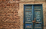 A blue door with Arabic writing, Luxor town, Egypt.
