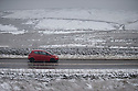 12/01/17<br />  <br /> A car drives between snow-covered dry stone walls on the A53 Axe Edge between Leek and Buxton  in The Derbyshire Peak District. <br /> <br /> All Rights Reserved F Stop Press Ltd. (0)1773 550665   www.fstoppress.com