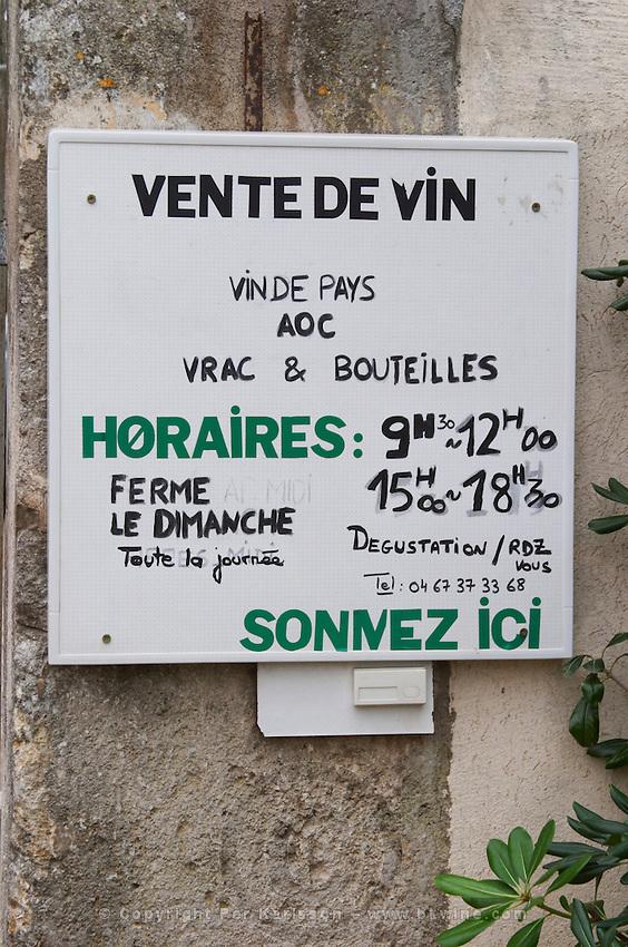 Opening hours, Vin de Pays, Appellation Controlee, bulk sales and bottle sales. Press the bell. Domaine Le Nouveau Monde. Terrasses de Beziers. Languedoc. France. Europe.