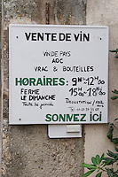 Opening hours, Vin de Pays, Appellation Controlee, bulk sales and bottle sales. Press the bell. Domaine Le Nouveau Monde. Terrasses de Beziers. Languedoc. France. Europe.