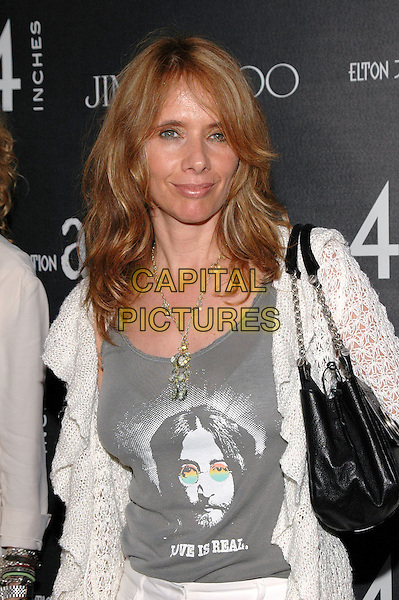 "ROSANNA ARQUETTE.At Cartier on 5th Avenue for the launch of the book ""4 Inches""- a new coffee table book featuring 44 celebrities wearing nothing but Cartier jewelry and Jimmy Choo shoes. Several photos from the book will be auctioned off to benefit the Elton John Aids Foundation..New York, New York, USA, 16 June 2005..half length John Lennon slogan black and white top t-shirt t shirt .Ref: ADM.www.capitalpictures.com.sales@capitalpictures.com.©Patti Ouderkirk/AdMedia/Capital Pictures."