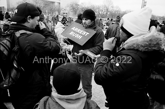 Washington DC<br /> District of Columbia<br /> USA<br /> January 19, 2009<br /> <br /> Crowds file down the National Mall one day before the presidential inauguration of Barack Obama. A euphoric atmosphere filtered through the air in anticipation of the first black president in US to take the office.
