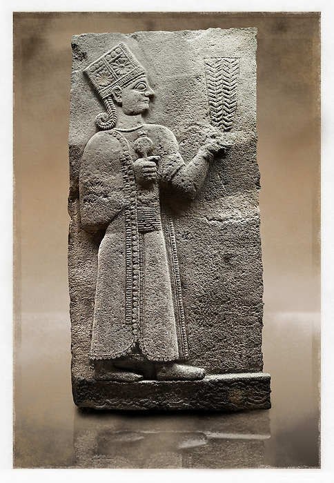 Picture & image of a Neo-Hittite orthostat showing a releif sculpture  of the Goddess Kubaba from Karkamis,, Turkey. Museum of Anatolian Civilisations, Ankara. In her right hand she is holding a pomegranate