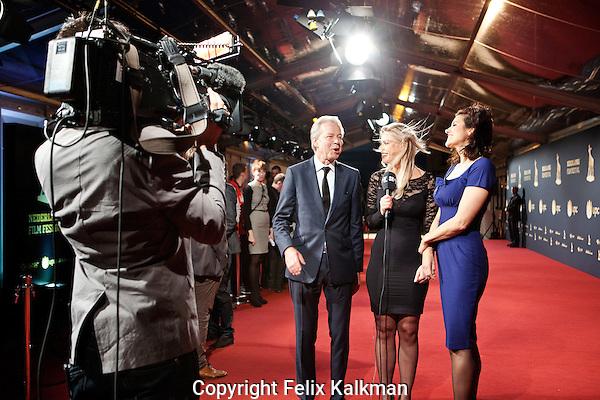 Utrecht, 25 september 2014<br /> Nederlands Film Festival<br /> Premiere Het Spel van de Wolf<br /> Producent Gijs van de Westelaken en actrice Susan Visser in een live televisie interview op de rode loper<br /> Foto Felix Kalkman