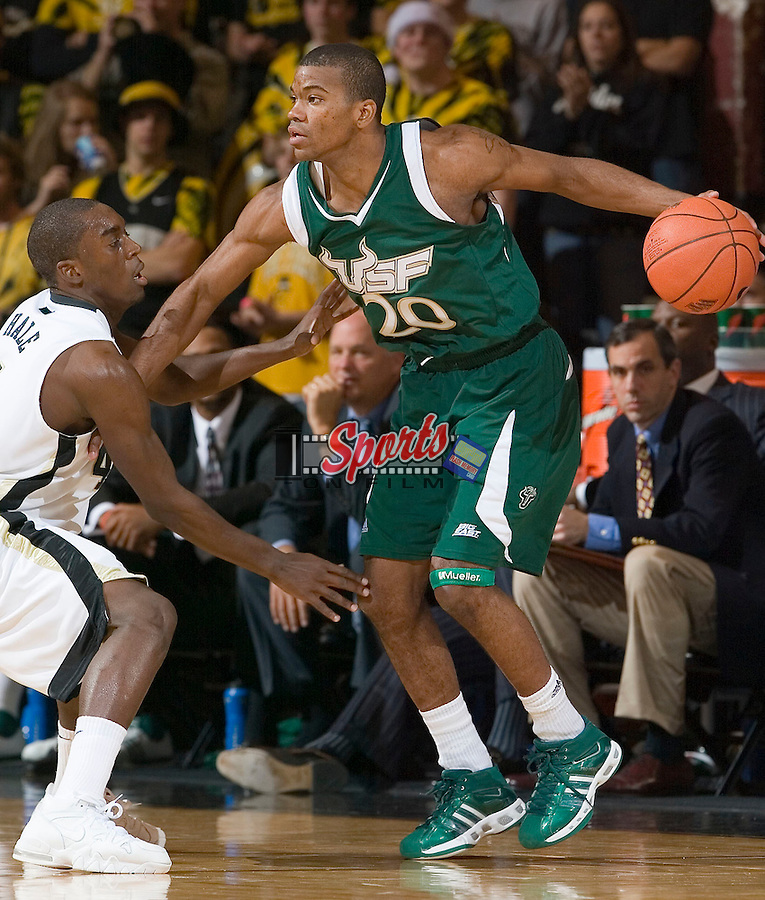 South Florida's Aaron Holmes (20) tries to avoid the defensive pressure from Wake Forest's Harvey Hale (4) during second half action at the LJVM Coliseum Wednesday, December 19, 2007 in Winston-Salem, NC.