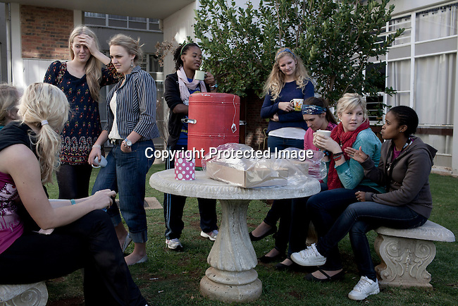 BLOEMFONTEIN, SOUTH AFRICA APRIL 18, 2013: Female students chat during a 4pm tea break at the Rosemaryn residence at the University of the Free State in Bloemfontein, South Africa. Photo by: Per-Anders Pettersson