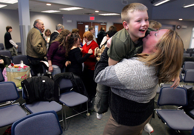 "Kelly Pickett lifts and hugs her son, Mattheu (cq), 8, following her graduation from intensive supervision drug court Friday, January 25 at Bridges of Iowa, a drug and alcohol rehabilitation center in West Des Moines. She thanked Mattheu for his patience while she ""grew up"" in the program."