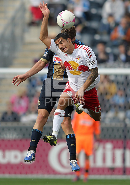 CHESTER, PA - OCTOBER 27, 2012:  Chris Albright (3) of the Philadelphia Union pushes into the back of  Tim Cahill (17) of the New York Red Bulls during an MLS match at PPL Park in Chester, PA. on October 27. Red Bulls won 3-0.