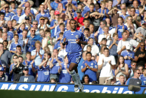 9 September 2006: Chelsea defender Ashley Cole runs across the pitch on his debut during the Premiership game between Chelsea and Charlton Athletic played at Stamford Bridge. Chelsea won the match 2-1. Photo: Actionplus...060909 player football soccer
