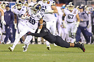 Philadelphia, PA - December 8, 2018:   Navy Midshipmen tight end Keoni-Kordell Makekau (28) gets tackled by an Army Black Knights defender during the 119th game between Army vs Navy at Lincoln Financial Field in Philadelphia, PA. (Photo by Elliott Brown/Media Images International)