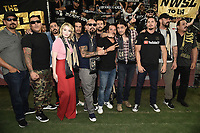 "LOS ANGELES - AUGUST 21: Michael Perez, Frankie Loyal, Gino Vento, Sarah Bolger, Richard Cabral, Joseph Lucero, Salvador Chacon, Michael Irby, Antonio Jaramillo, JD Pardo, Clayton Cardenas and Emilio Rivera at FX's ""Mayans M.C."" Activation at Los Angeles Football Club at Banc of California Stadium on August 21, 2019 in Los Angeles, California. (Photo by Scott Kirkland/FX Networks/PictureGroup)"