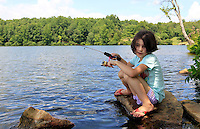 Ava Grey Shurtleff catches her first fish at Chris Greene Lake in Albemarle County, VA. Photo/Andrew Shurtleff
