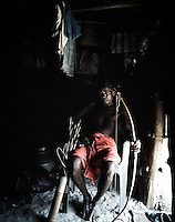 50 year old Subulu Munduya sits with his bow and arrow inside his hut in Balighato village of Kalinganagar industrial area in Orissa. On 2 January 2006, the police in Kalinganagar opened fire on a group of tribals protesting against Tata's constructon of a steel plant on their land without having paid them adequate compensation. The killing of 12 villagers, including Subulu's brother Rangal, shocked the whole nation and all but paralysed the state government over the land issue. Armed with bows and arrows, the villagers from Balighato village of Kalinganagar keep a tight vigil at the entrance of their village to stop company officials or police entering their land.