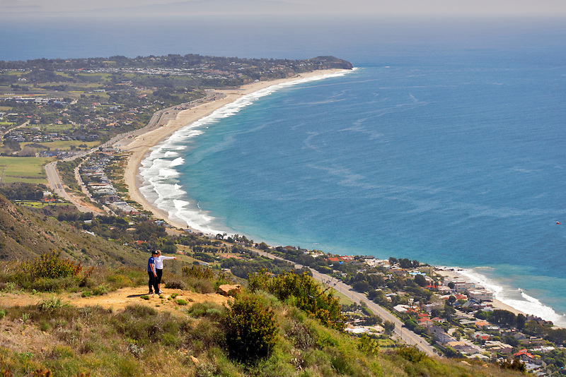 Couple hiking on coast of California. Charmlee Wilderness Area overlooking Zuma Beach in Malibu.