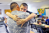 After not seeing his step father for 7 months while he was in Iraq, Owen Kirk jumps into his step-father, John Springer's arms Tuesday morning at 9:40AM when his father showed up at Owen's 4th grade class at H.M. Pearson Elementary to surprise him.