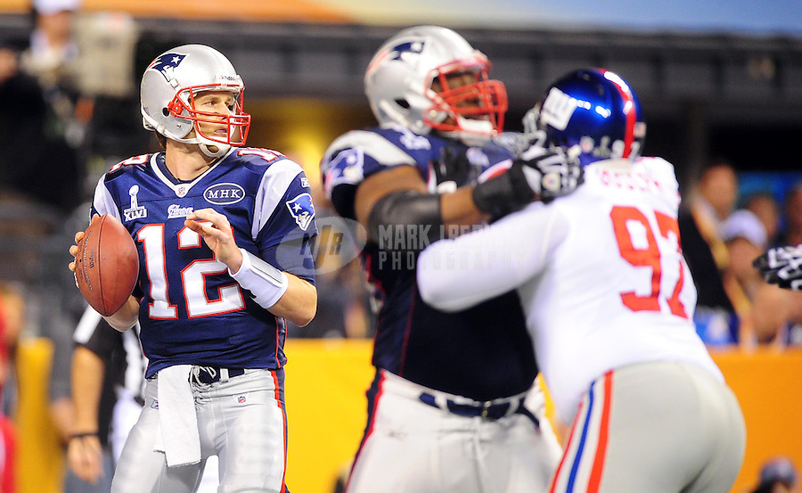 Feb 5, 2012; Indianapolis, IN, USA; New England Patriots quarterback Tom Brady (12) drops back to pass during the first half of Super Bowl XLVI against the New York Giants at Lucas Oil Stadium.  Mandatory Credit: Mark J. Rebilas-