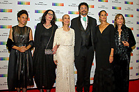 Carmen de LaVallade and her son, Leo Holder and family, arrive for the formal Artist's Dinner honoring the recipients of the 40th Annual Kennedy Center Honors hosted by United States Secretary of State Rex Tillerson at the US Department of State in Washington, D.C. on Saturday, December 2, 2017. The 2017 honorees are: American dancer and choreographer Carmen de Lavallade; Cuban American singer-songwriter and actress Gloria Estefan; American hip hop artist and entertainment icon LL COOL J; American television writer and producer Norman Lear; and American musician and record producer Lionel Richie. Photo Credit: Ron Sachs/CNP/AdMedia