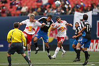 San Jose Earthquakes midfielder Ramiro Corrales (12) goes up for a header with New York Red Bulls forward John Wolyniec (15) and midfielder Claudio Reyna (10). The New York Red Bulls defeated the San Jose Earthquakes 2-0 during a Major League Soccer match at Giants Stadium in East Rutherford, NJ, on April 27, 2008.