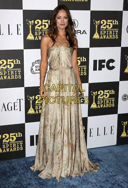 OLIVIA WILDE .25th Annual Film Independent Spirit Awards held At The Nokia LA Live, Los Angeles, California, USA,.March 5th, 2010 ..arrivals Indie Spirit full length strapless beige gold print printed patterned pattern dress necklace clutch bag long maxi .CAP/ADM/KB.©Kevan Brooks/Admedia/Capital Pictures