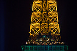 A detail of the construction of the Eiffel Tower by night