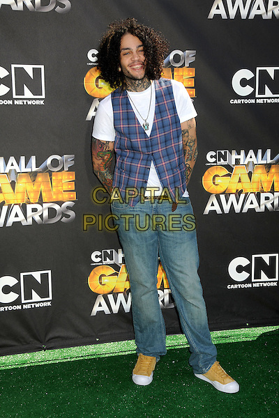 TRAVIE McCOY.1st Annual Cartoon Network Hall of Game Awards held at Barker Hangar, Santa Monica, California, USA..February 21st, 2011.full length blue plaid tartan waistcoat t-shirt tattoos rings beard facial hair travis necklace jeans denim.CAP/ADM/BP.©Byron Purvis/AdMedia/Capital Pictures.