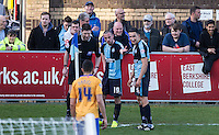 Michael Harriman of Wycombe Wanderers & Luke O'Nien of Wycombe Wanderers smile as they hold the ball up at a corner during the Sky Bet League 2 match between Wycombe Wanderers and Mansfield Town at Adams Park, High Wycombe, England on 25 March 2016. Photo by Andy Rowland.