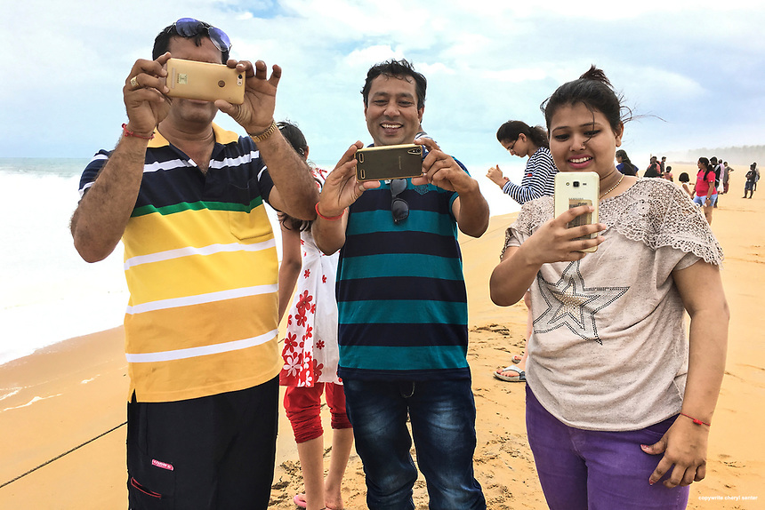 Locals taking pictures of an American visitor taking a picture of locals at Poovar Golden Beach in Thiruvananthapuram,  Kerala, India  June 6, 2017.   (Cellphone Photo by Cheryl Senter)