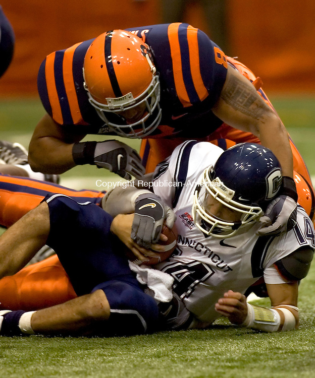 SYRACUSE, NY--18 NOVEMBER 2006--111806JS11-UConn quarterback D.J. Hernandez injured his arm on this tackle by Syrcause's Kelvin Smith during UConn's 20-14 loss to Syracuse Saturday at the Carrier Dome in Syracuse, New York. <br /> Jim Shannon / Republican-American