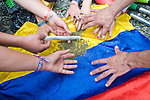 A group of young women smoke marijuana on the flag of Colombia in the streets of Medellin. during celebrations of the International Day of the Marijuana and for the legalization in Medellin, Colombia, May 5, 2012. Photo by Fredy Amariles/VIEWpress.