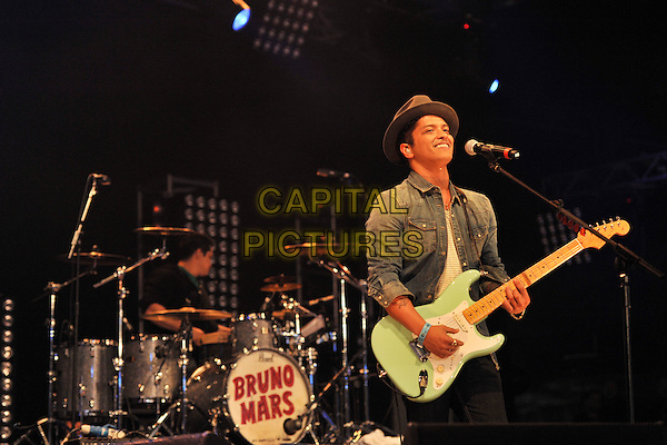 BRUNO MARS .At Radio 1's Big Weekend, Carlisle, England, UK, May 15th 2011..music festival live on stage performing microphone half length denim shirt hat guitar playing .CAP/MAR.© Martin Harris/Capital Pictures.