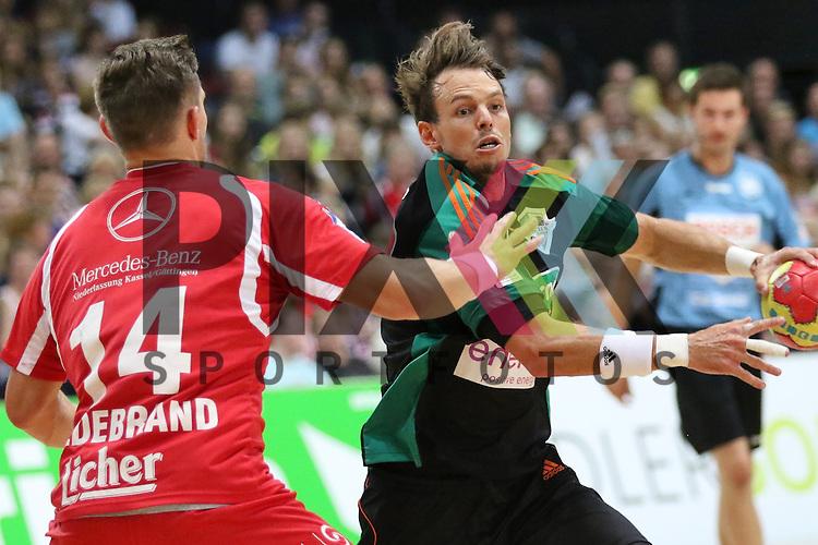 Bremen, 09.08.15, Sport, Handball, Erima-Cup 2015, MT Melsungen-TSV Hannover-Burgdorf : Christian Hildebrand (MT Melsungen, #14), Kai H&auml;fner (TSV Hannover-Burgdorf, #17)<br /> <br /> Foto &copy; P-I-X.org *** Foto ist honorarpflichtig! *** Auf Anfrage in hoeherer Qualitaet/Aufloesung. Belegexemplar erbeten. Veroeffentlichung ausschliesslich fuer journalistisch-publizistische Zwecke. For editorial use only.