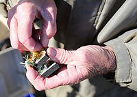 NWA Democrat-Gazette/DAVID GOTTSCHALK Melvin Binam picks out a home made lure to fish for trout Monday, December 2, 2019, at Murphy Park in Springdale. The lake was recently stocked with trout by the Arkansas Game and Fish Commission. Binam spent his morning in Springdale and then went to Lake Fayetteville to fish for crappie and brim.