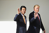 U.S. President Donald Trump and Japan Prime Minister Shinzo Abe walk together to their joint press conference in the East Room at the White House on February 10, 2017 in Washington, DC. This is Abe's first official state visit during the Trump administration.  <br /> Credit: Chip Somodevilla / Pool via CNP
