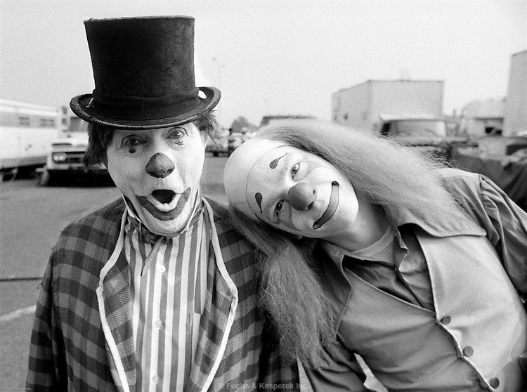 A father and son clown team pose outside a circus in Jackson, Miss., 1976.
