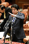 February 12, 2013, Tokyo, Japan - Japan's Prime Minister Shinzo Abe answers questrions asked by Shintaro Ishihara of the opposition Japan Restoration Party regarding the air space surrounding U.S. Yokota Air Base during a question-and-answer session of the Diet lower house Budget Committee in Tokyo on Tuesday, February 12, 2013. (Photo by AFLO)
