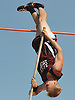 North Shore senior Michael Caldwell soars through the air in the boys' pole vault event during the Nassau County Class A varsity track and field championships at Roosevelt High School on Friday, May 29, 2015. He won the competition by a large margin after clearing the bar at 14 feet.<br /> <br /> James Escher