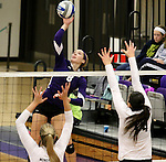 SIOUX FALLS, SD - OCTOBER 4:  Emily Johnson #8 from the University of Sioux Falls looks to get a kill past a pair of defenders including Mallory Sall #14 from Minot State during their game Saturday afternoon at the Stewart Center. (Photo/Dave Eggen/Inertia)