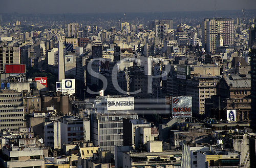 Buenos Aires, Argentina. Oblique aerial view of city centre high rise buildings and advertisements.