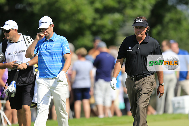 Justin Rose (ENG) and Phil Mickelson (USA) walk off the 14th tee during Friday's Round 1 of the 2013 Bridgestone Invitational WGC tournament held at the Firestone Country Club, Akron, Ohio. 2nd August 2013.<br /> Picture: Eoin Clarke www.golffile.ie