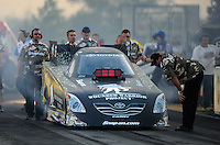 Jul, 8, 2011; Joliet, IL, USA: NHRA funny car crew members for driver Cruz Pedregon during qualifying for the Route 66 Nationals at Route 66 Raceway. Mandatory Credit: Mark J. Rebilas-